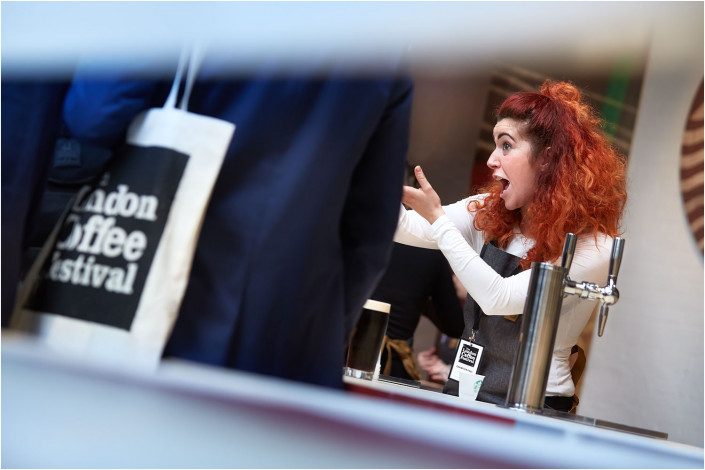 person selling coffee at exhibition