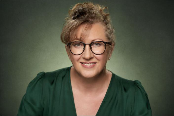 female studio headshot against backdrop