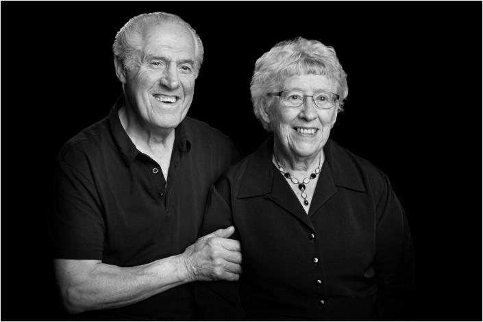 older couple in studio against black background