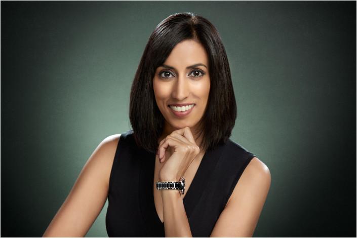 executive lady in studio headshot against backdrop