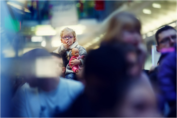 child in crowd at shopping centre