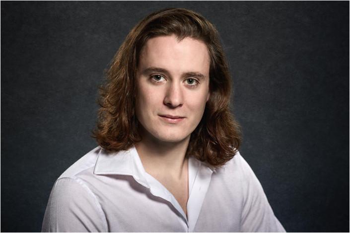 long haired man in studio portrait