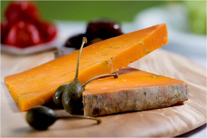 food photography with cheese and olives on plate