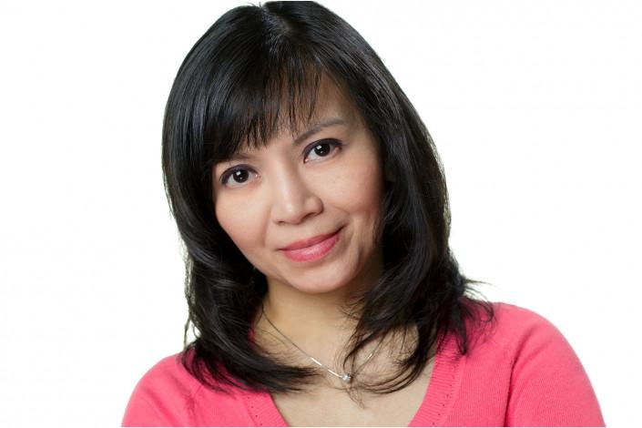 lady in studio headshot against white backdrop