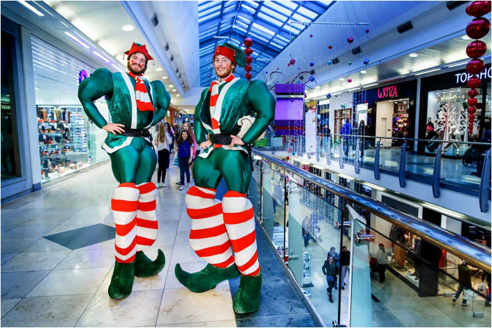 circus performers on stilts at shopping centre