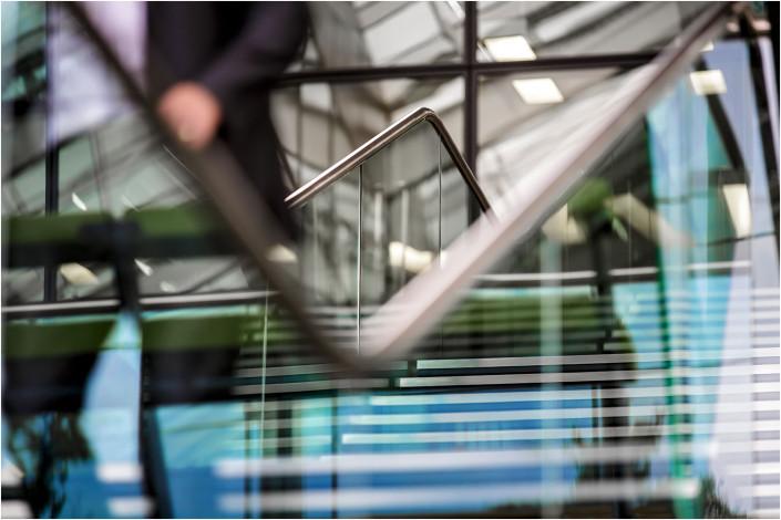 office interior hand on rail