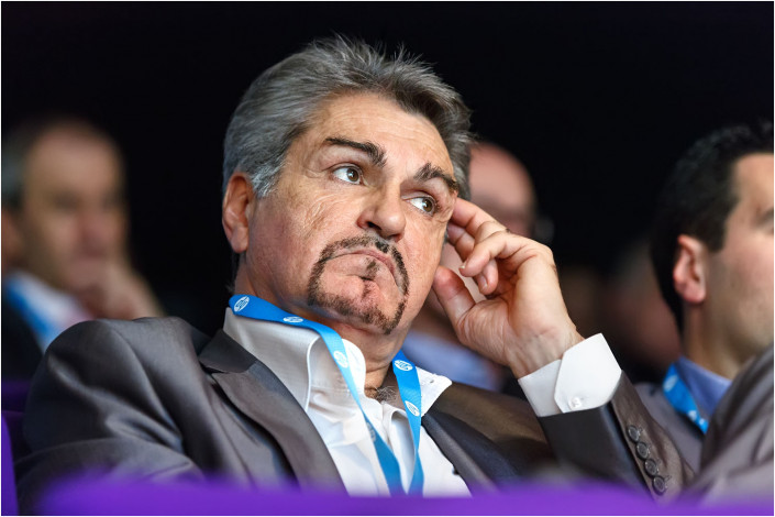 man in audience listening to conference speaker
