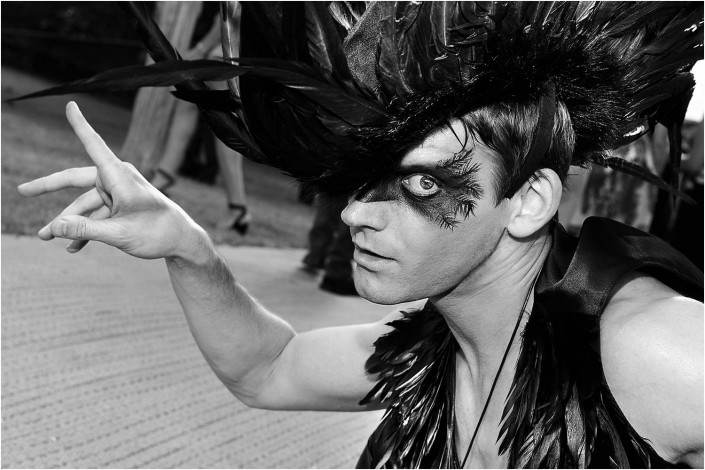 circus performer at a party in black and white