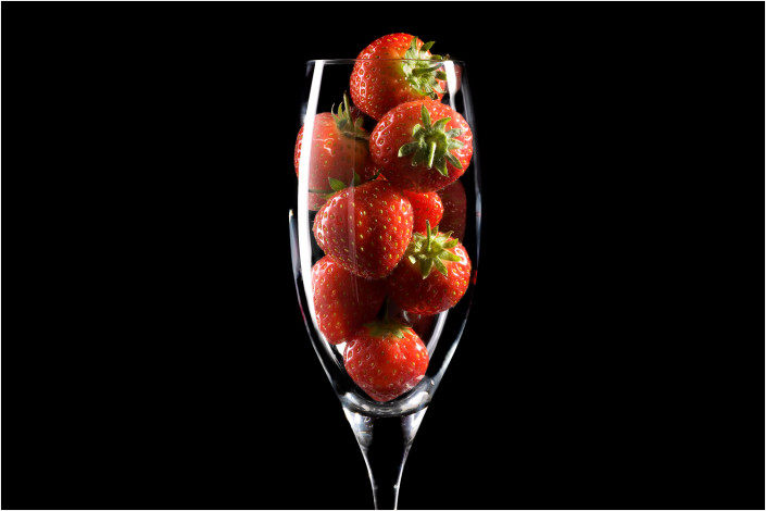 food photography of strawberries in champagne glass