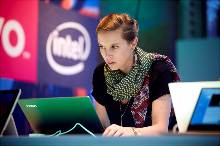 lady on computer at technology exhibition