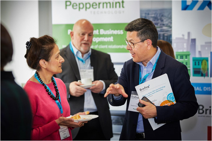 gorup at a conference having a lively chat