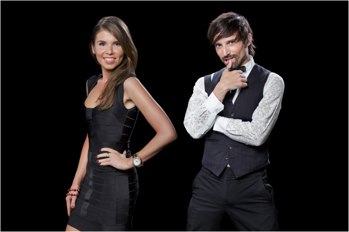 couple standing against black backdrop