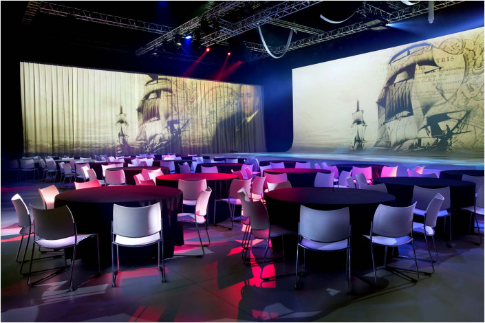 large empty conference venue with seats and tables