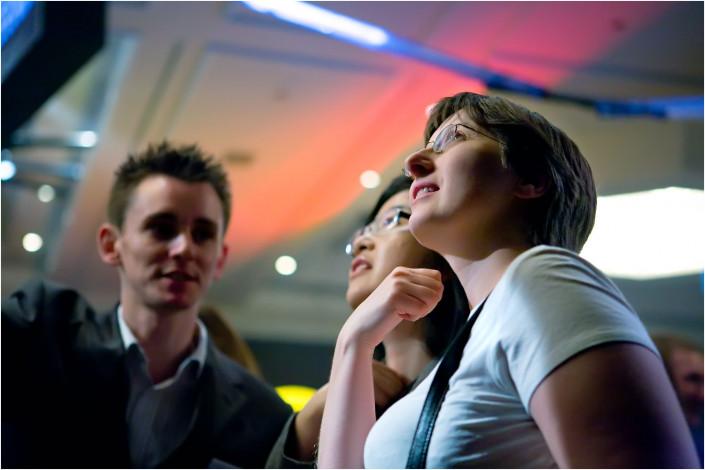 group looking upwards at a display