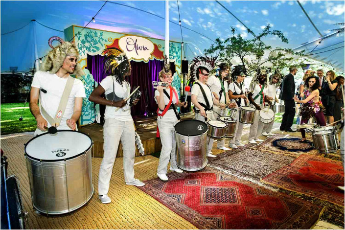 lively drum band playing at a pary