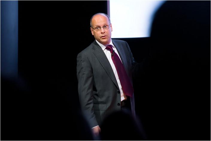 man speaking to conference delegates