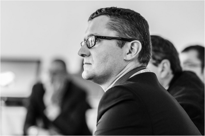 man listening at a conference speech