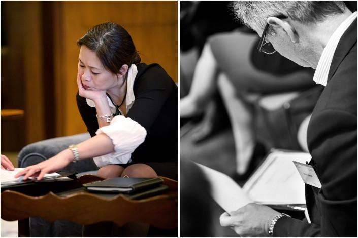 delegates checking paperwork