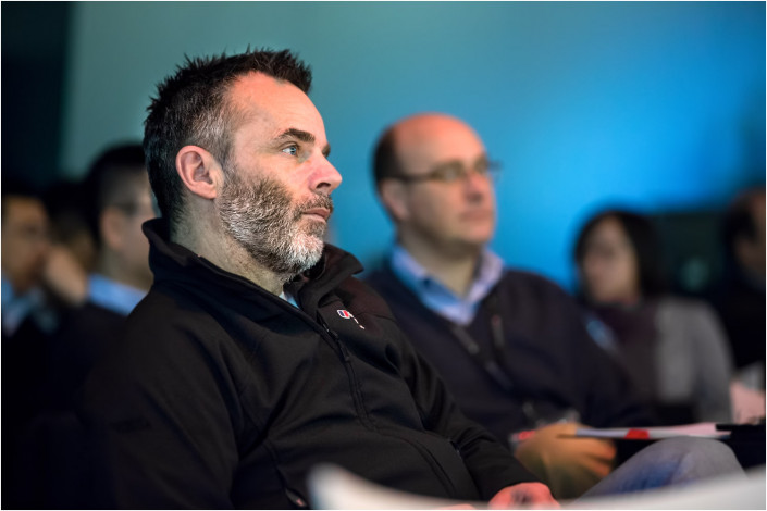 men listening in the audience