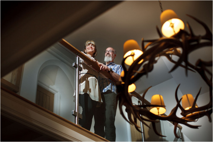 couple portraiture at top of stairs