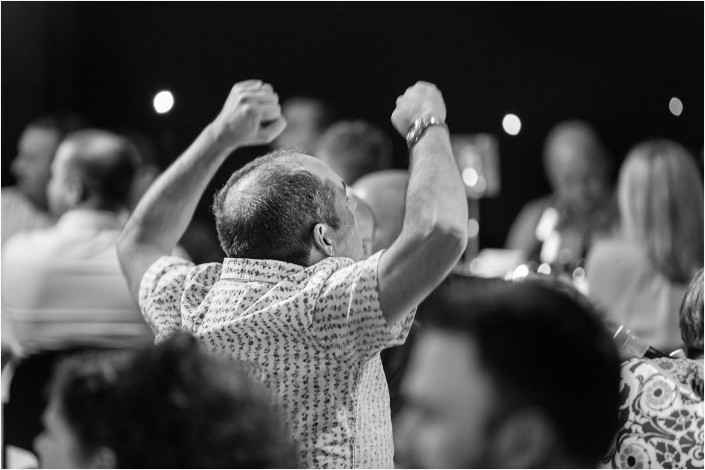 man celebrating at conference