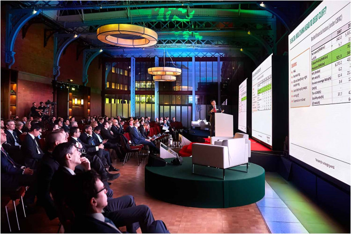 wide image of conference and screens