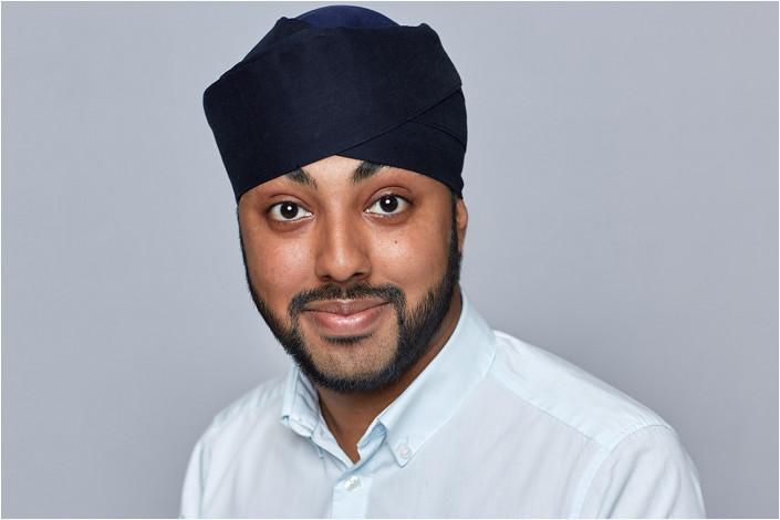 male in turban studio headshot against backdrop