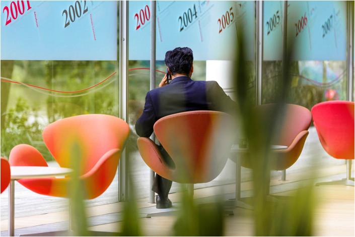 man sitting in office interior