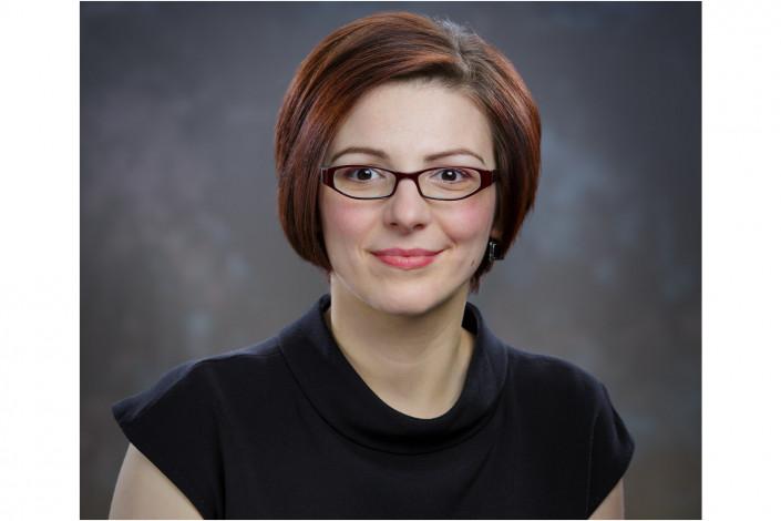 lady in studio headshot against backdrop