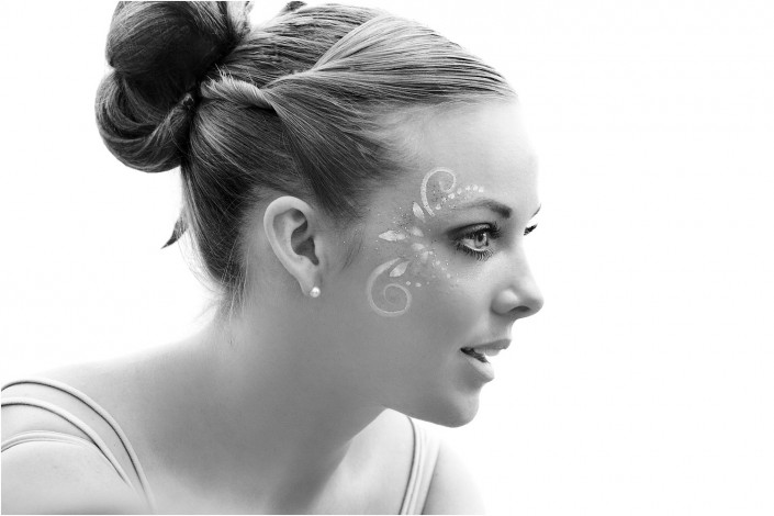 lady with face paint in black and white photograph