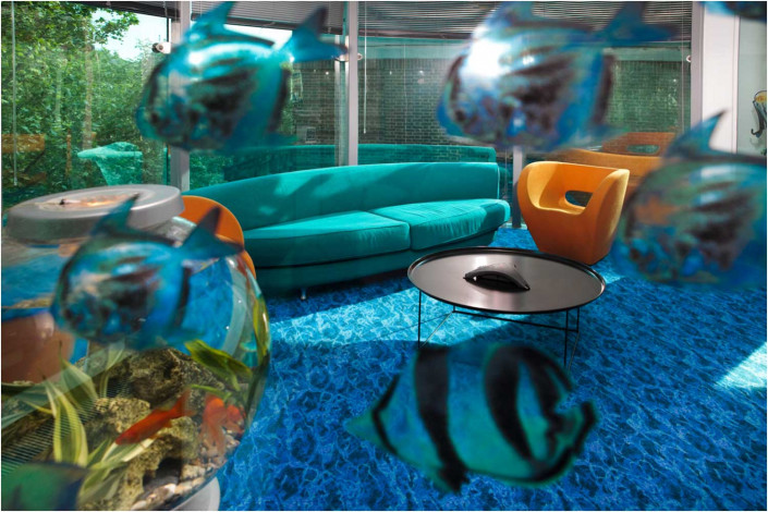 office seating area with goldfish