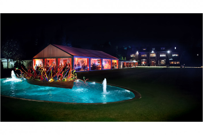 venue exterior of marquee by large house at night