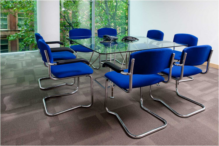 small conference room with desk and chairs
