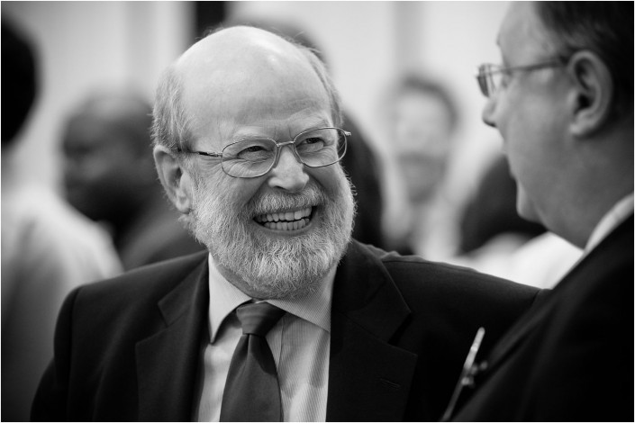 man laughing at a conference