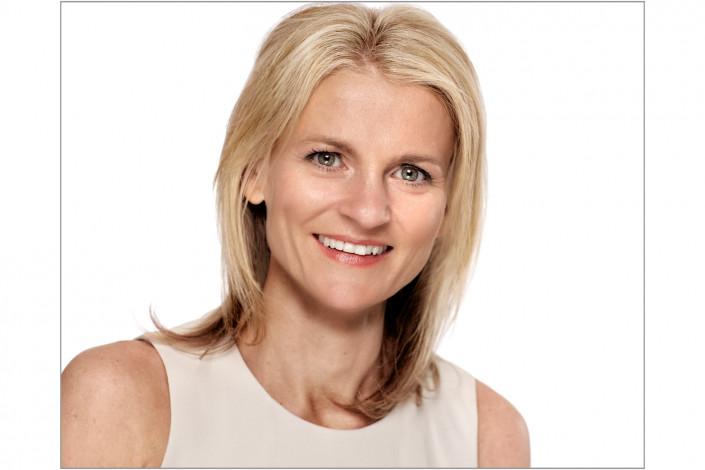 executive female studio headshot against white backdrop