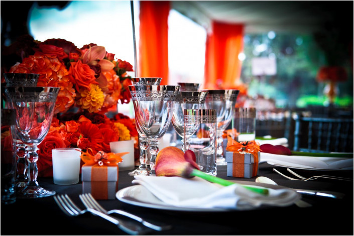table setting with orange theme for party