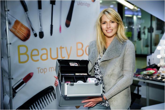 lady holding makeup box at a display