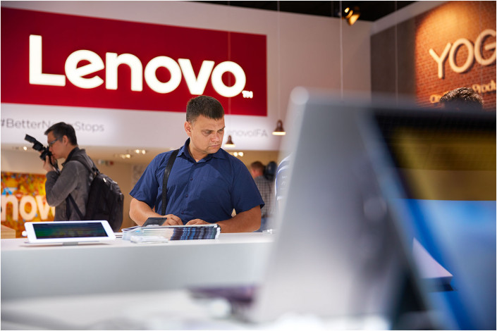 man looking at display during lenovo exhibition