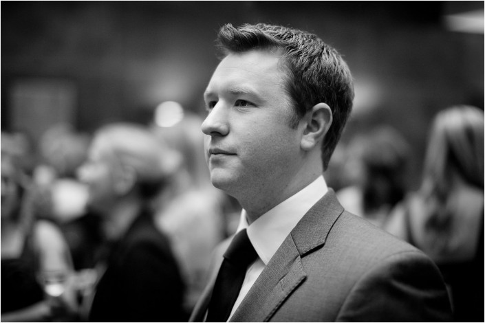 serious man at a conference in black and white