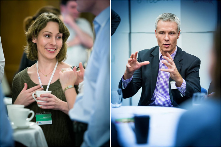 man and woman engaged in conversation at a conference