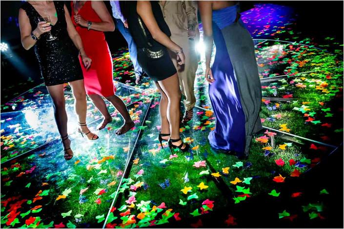 ladies' feet on glass floor with glowing lighting